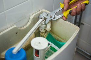 Fixing_broken_toilet-min.jpg