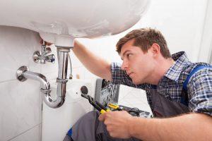 Plumber_installing_new_bathroom_sink-min-1.jpg