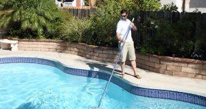man-cleaning-his-home-pool-net-mst.jpg