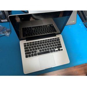 Apple Macbook Pro keyboard repair blue table in Dallas TX.jpg