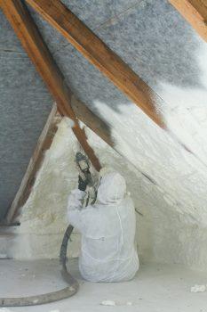 Spraying Foam Insulation on the attic to reduce heat exchange.jpg