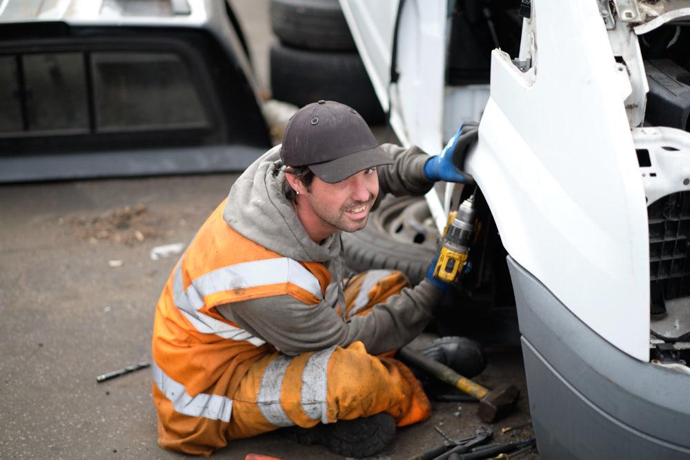 Reclamet Salvaging spare parts off a van.jpg