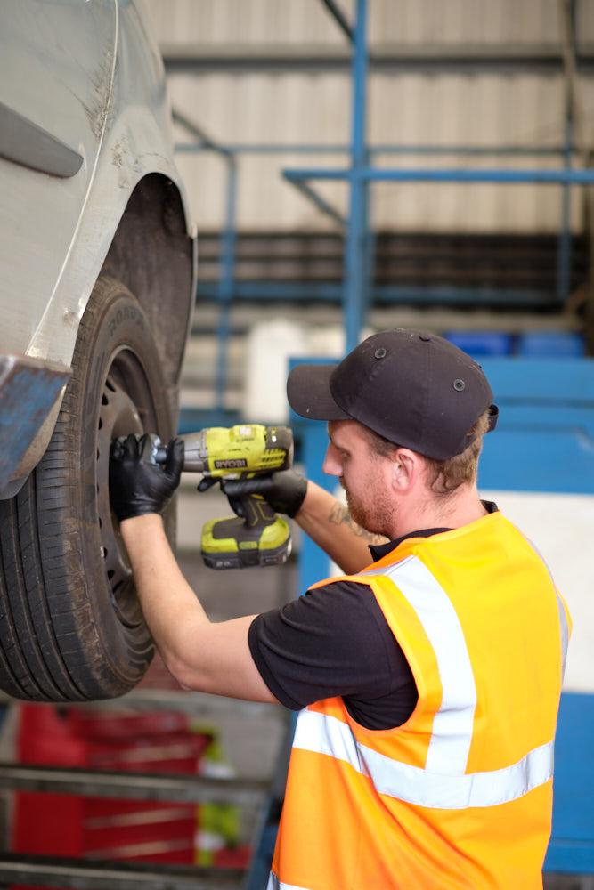 Reclamet replacing a car wheel.jpg