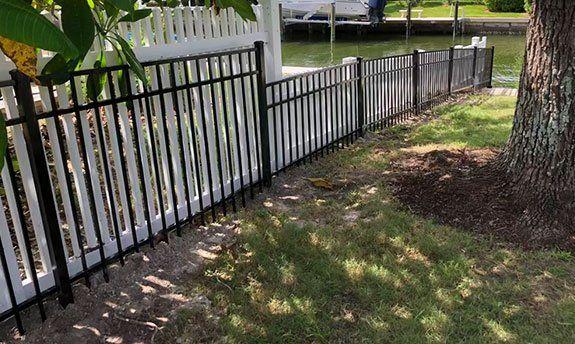 black-aluminum-fence-installation-1920w.jpg